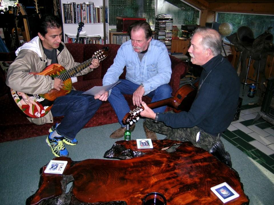 Three men in Arndt's home.