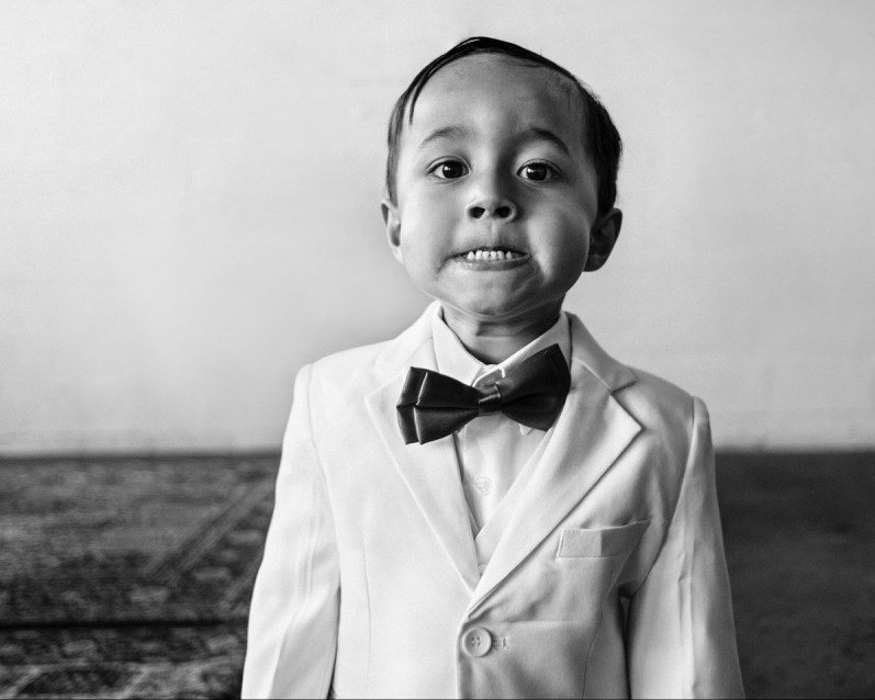 Jamie Poh won Photojournalistic Wedding Best in Class for Tooth 'Barer'.