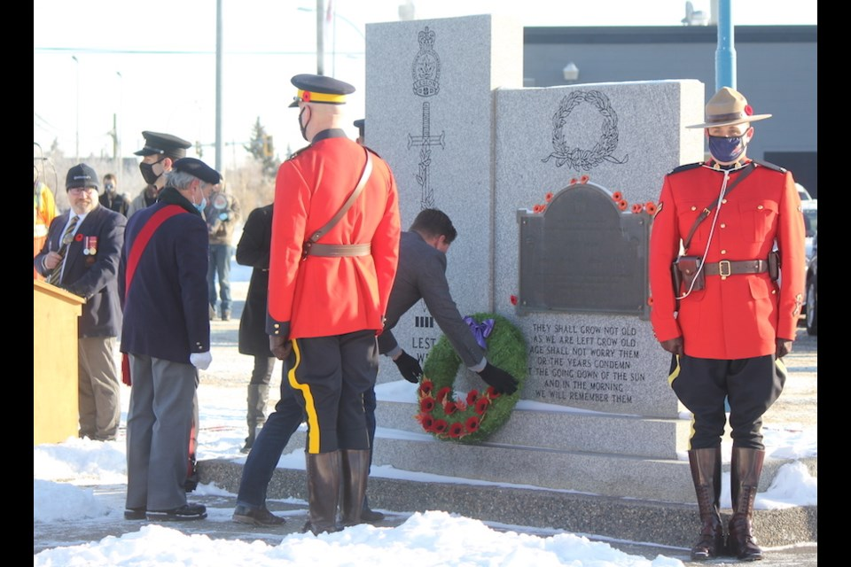 Dax Bourke, a retired corporal and Aghanistan war veteran, lays the first wreath at the Fort St. John cenotaph, Nov. 11, 2020.