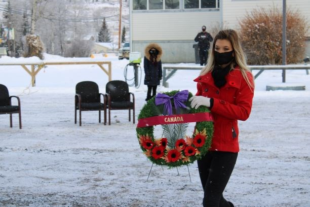 Hudson's Hope Recreation and Events and Co-ordinator Kristina Coombs places a wreath, Nov. 11, 2020.