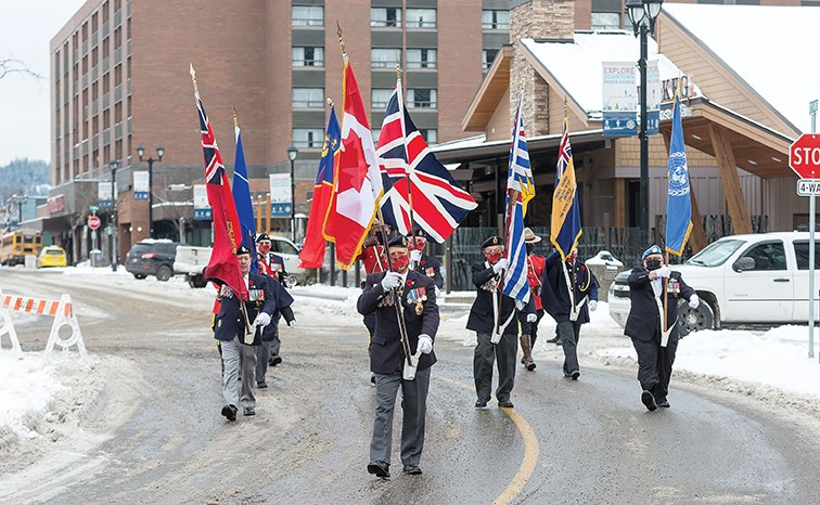 Citizen Photo by James Doyle/Local Journalism Initiative. The Royal Canadian Legion Colour Party marches towards the cenotaph in front of city hall on Wednesday morning at the Prince George Remembers Remembrance Day ceremony.