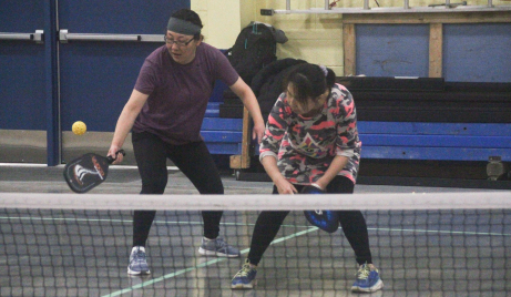 Christina Guo gets to a serve during Peace Country Pickleball action on November 11, 2020, while her teammate ducks out of the way.