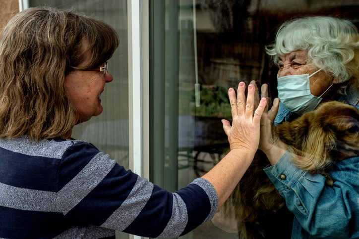 A daughter visits her quarantined mother during the COVID-19 pandemic