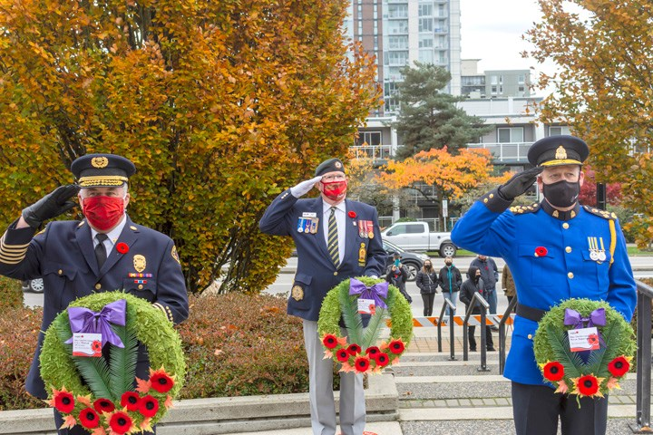Tim Armstrong, New Westminster fire chief, (left), Terry Leith, president of the Royal Canadian Legion Branch #2 (middle), Chief Const. Dave Jansen of the New West police (right) at the Nov. 11 New Westminster Remembrance Day ceremony. Photo by Lief Garrett