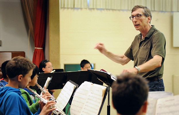 General Wolfe elementary band teacher Peter Findlay conducts one of his last music classes at the school this week. Scan page with Layar to see more photos.