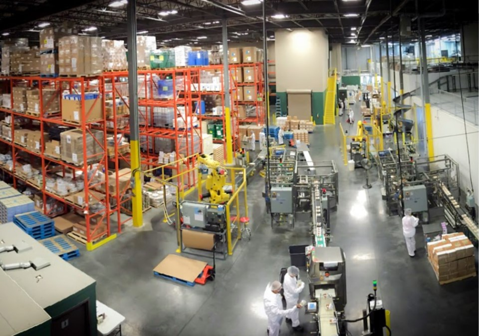 Inside the Nutri-Nation Functional Foods plant, workers work so close. But no matter what measures a