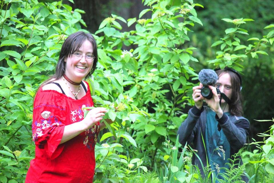 Emily van Lidth de Jeude and Taliesin in a leafy bush