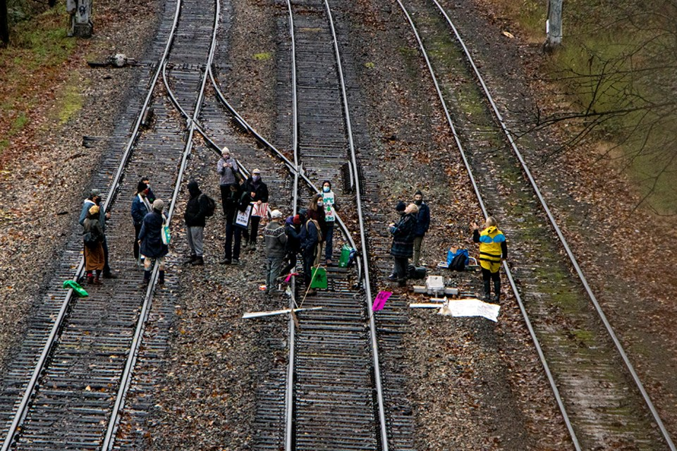 Extinction Rebellion demonstrators occupy a CN railroad in Burnaby, near Highway 1 and North Road, in protest against the Trans Mountain pipeline expansion project, which is slated for construction next to the railroad.