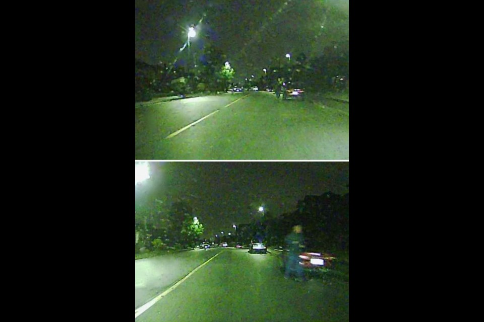 Photos taken from a dash cam showing a man in dark grey clothing running along the street. Coquitlam Mayor Richard Stewart posted these photos on Facebook and expressed concern about people wearing dark clothes at night on city streets.