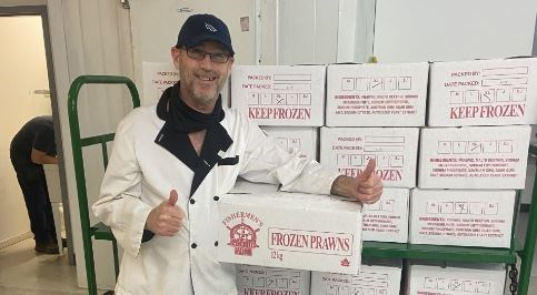 """Mike Miller, kitchen supervisor at the UGM New Westminster Resource Centre, was elated to receive the """"riches of the sea"""" due to a donation from Piva Modern Italian Restaurant."""