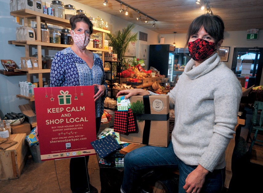 Bluhouse Cafe manager Iris Lucero and Sherwood Park Elementary PAC member Jeanette Schisler team up for a holiday gift box fundraiser that supports students while encouraging the shop local movement. photo Paul McGrath, North Shore News