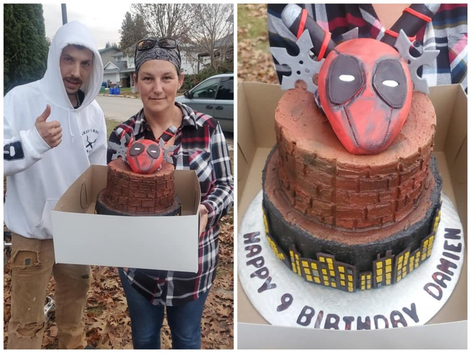 Damien's parents, Thomas Smith and Tiffanie Trudell, with Damien's Deadpool-themed cake. The nine-ye