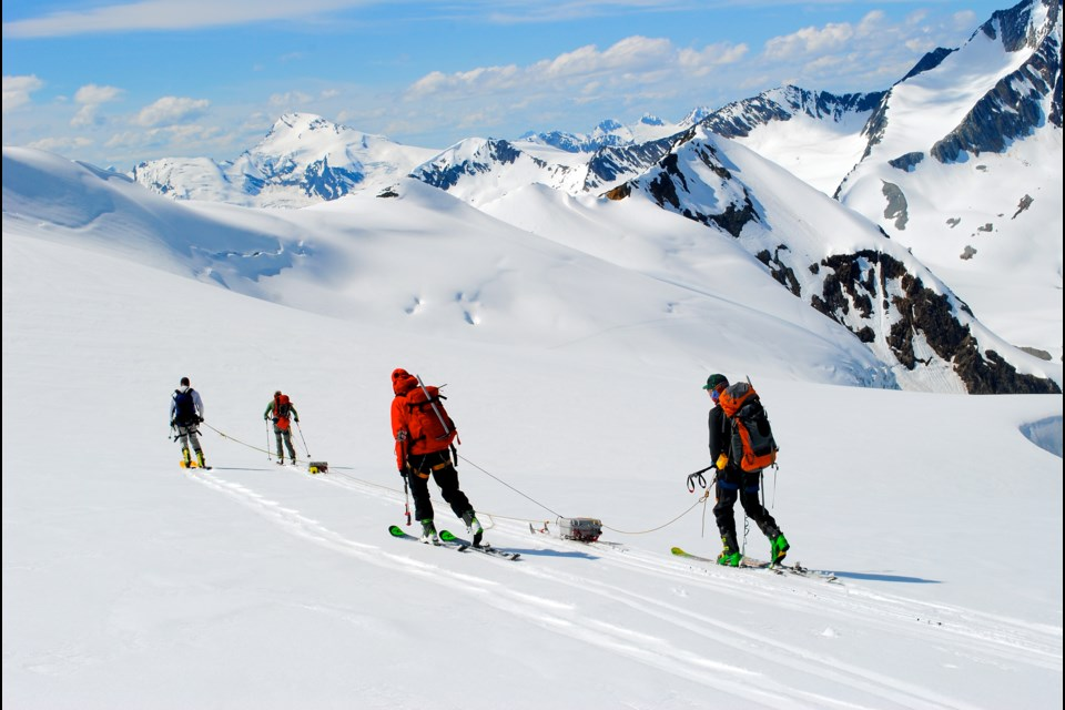 A research team led by the University of Northern British Columbia transports ice-penetrating radar across the Nordic glacier in the Columbia basin.