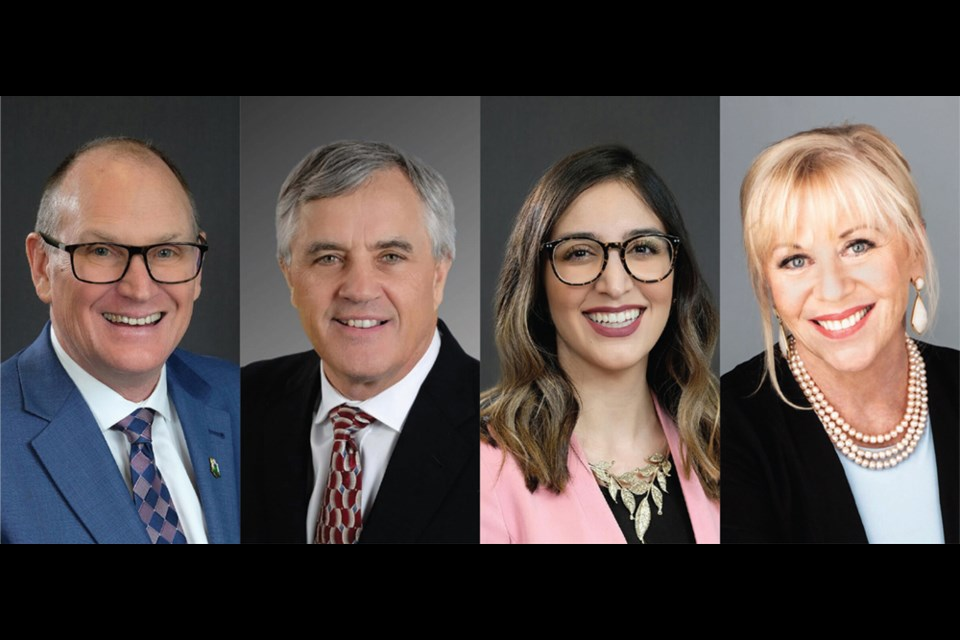 (From left to right): Jim Hanson, founder, Lawrence O'Neill, associate counsel, Naz Kohan, associate lawyer, Joanne Singleton, senior designated paralegal and office manager.