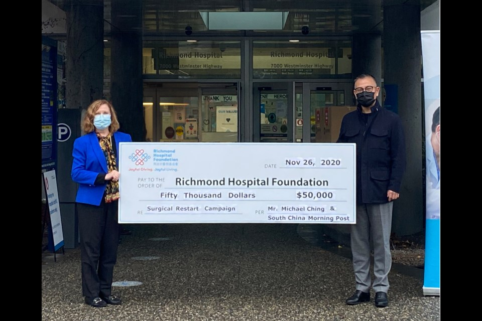 Natalie Meixner (left), president of the Richmond Hospital Foundation, receiving the donation from Michael Ching. Photo submitted