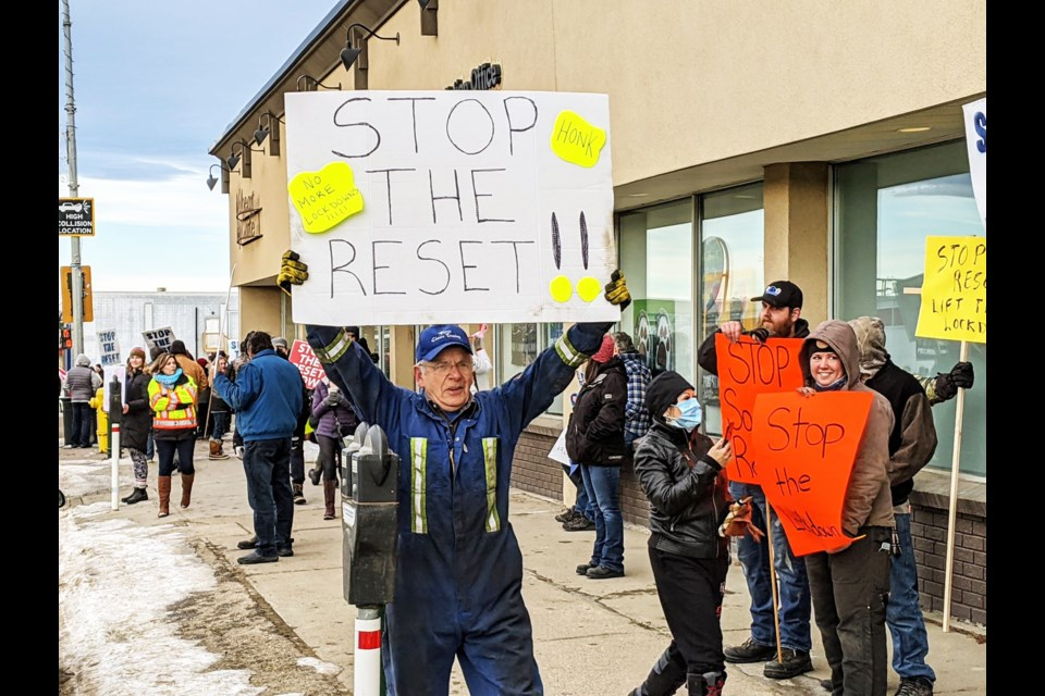 Protesters against the Canadian reset gathered on 100 Ave and 100 St. on December 1, 2020.