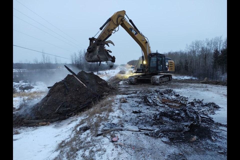 Crews work at the scene of an fatal tanker collision on the Alaska Highway, Dec. 14, 2020.
