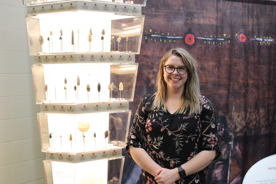 Fort St. John recreation manager Vanessa Cummings stands next to some replica arrowheads and casts of artifacts recovered during Site C construction, Dec. 15, 2020.