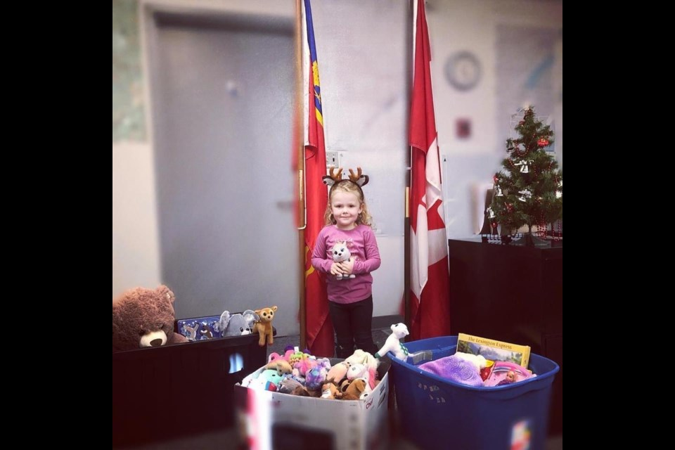 Young Freyja Schmidt after collecting toy bins from town.