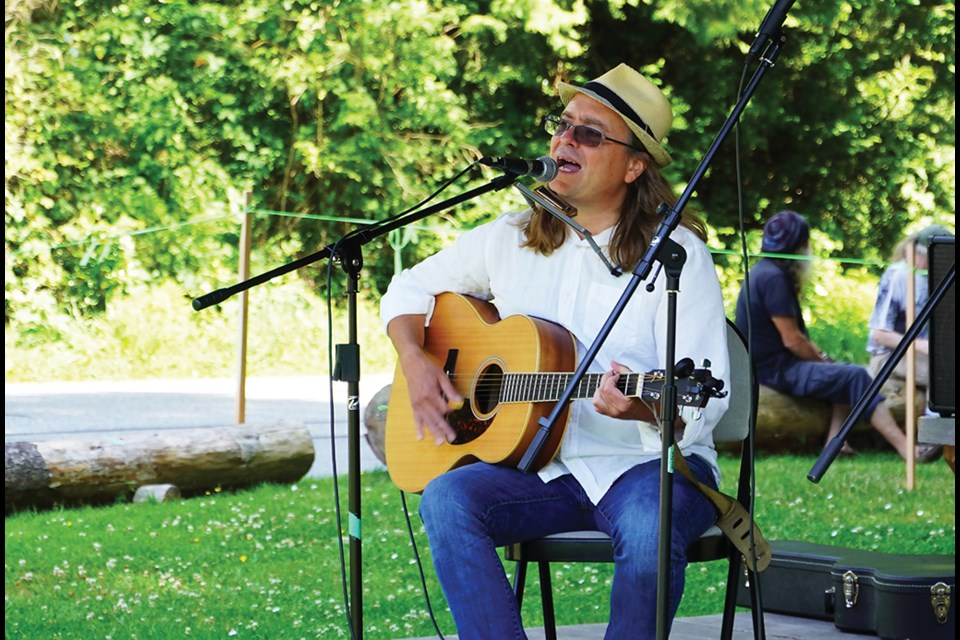 Grant Olsen performed some of his new tunes at Slow Sundays in Roberts Creek in July.