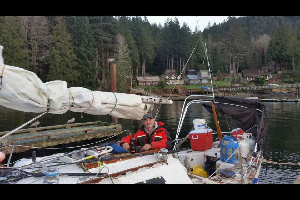 Kelly Kurik on his sailboat.