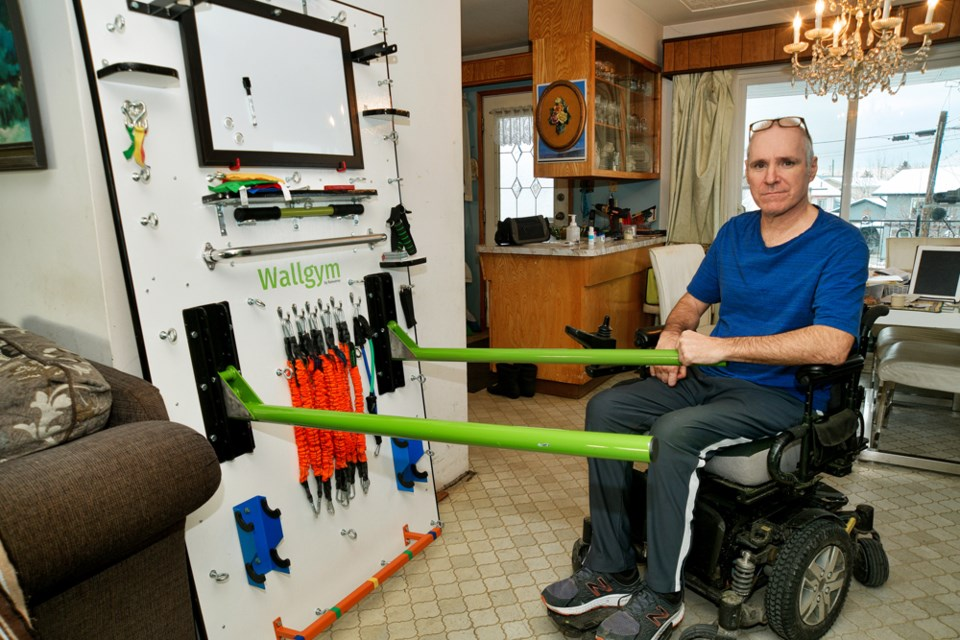 Antonio Ramunno with his Wallgym invention — an all-in-one compact exercise station designed for people with