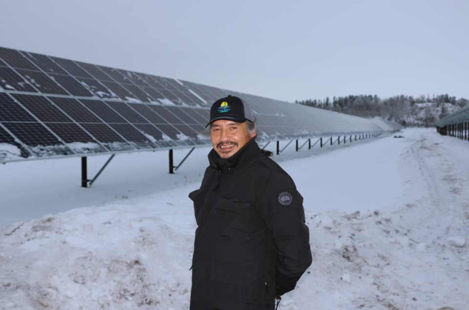 Chief Allan Adam of Athabasca Chipewyan First Nation with solar grid. | Three Nations Energy GP. Inc