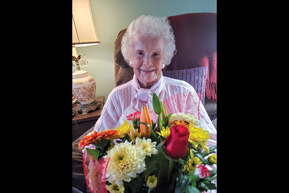 Doreen (Dody) Grant with flowers at her home on her birthday, Jan. 7.