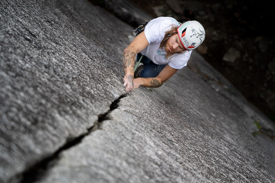 Harvey Writght climbing Arrowroot-Siy'ám' at the Smánit-Stawamus-Chief. Wright is featured in Crux: The Climb Towards Mental Health documentary.