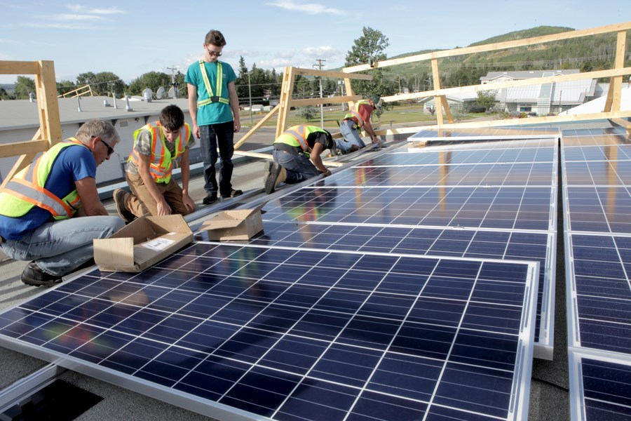 Solar panels being installed in Hudson's Hope. Silicon-based solar panels, shown at right, are the most common in use today.