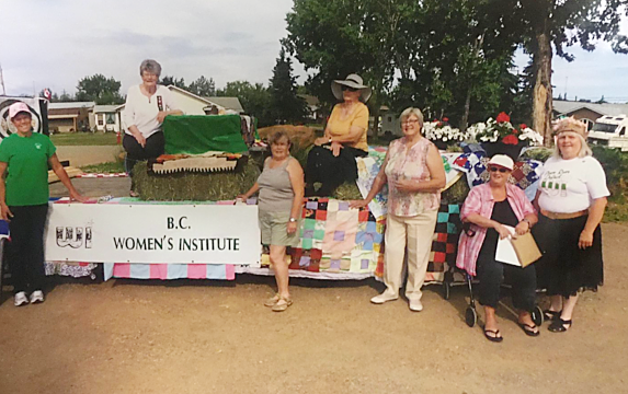 Fall fair float with the Peace River WI - Coleen Mathews, Ruth Veiner, Joan Holthe (president WI Canada) Barb Rose, Ethel Dyck, Nancy Germaine, and Judy Russel all Focus on Agriculture.