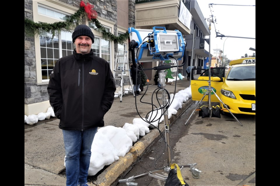 A Great North Christmas director James Douglas gets ready to shoot a scene for the movie Saturday in front of the Twisted Cork restaurant on Fifth Avenue. Filming will continue this week at various city locations and will wrap up on Saturday.