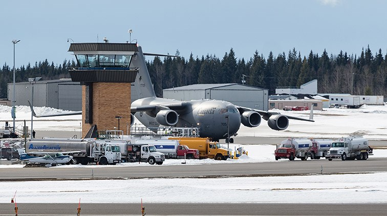 Citizen Photo by James Doyle/Local Journalism Initiative. A RCAF CC-177 Globemaster III transport plane overshadows the control tower prior to take off from Prince George Airport on Saturday afternoon.