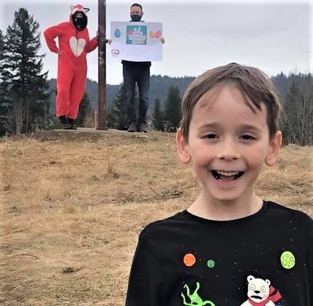 Five-year-old Micah Gagnon is all smiles as he poses for a photo, safely distanced from the elusive fox at Moore's Meadow, one of 25 destinations in the Most EGGcellent Cruise. The five-hour event Saturday afternoon drew close to 2,500 participants.