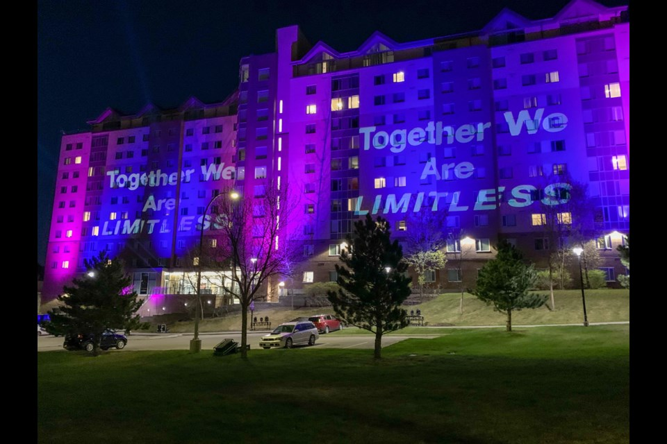 The university lit up the TRU Residence Building on Monday night (April 27) from 9 p.m. to 10:30 p.m. to mark the closing of the Limitless campaign.