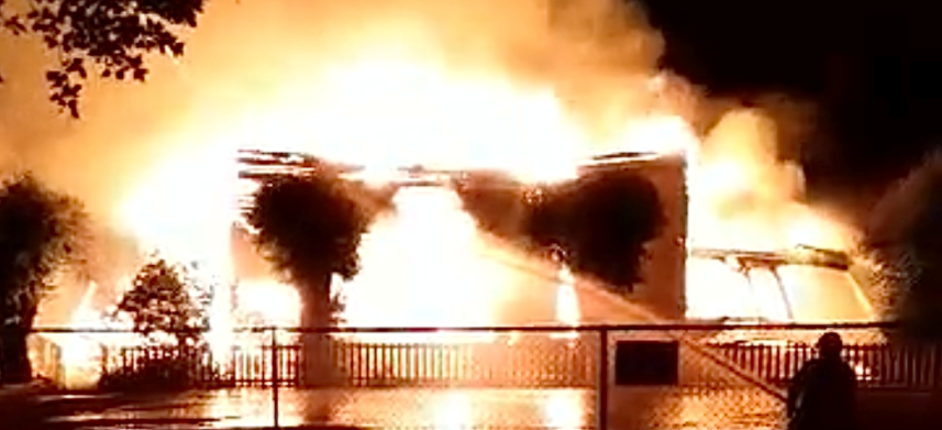 Flames rise from the Sacred Heart Church early on June 21, 2021.