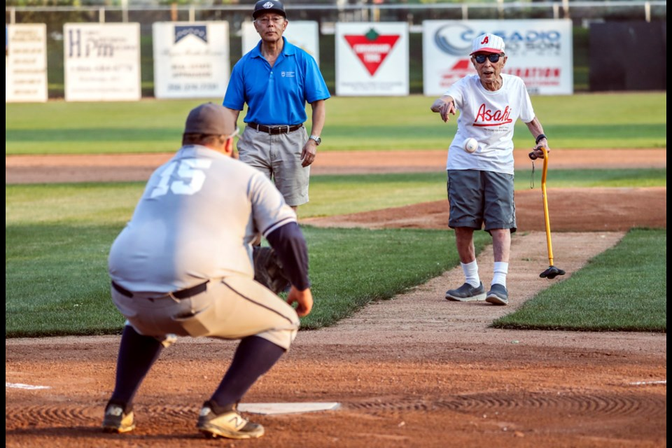 Kaye Kaminishi, one year shy of a century, throws the first pitch of the 2021 Kamloops Men's Baseball Season at Norbock Stadium on July 9, 2021.