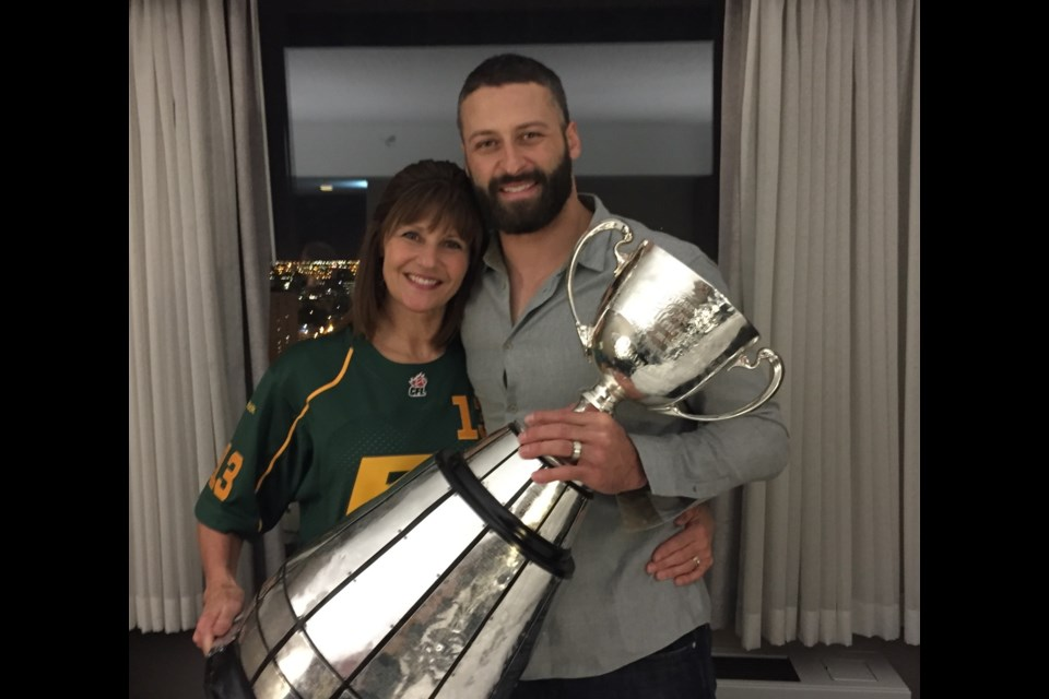 Rhonda Reilly and son Michael celebrate his Grey Cup victory with Edmonton in 2015.
