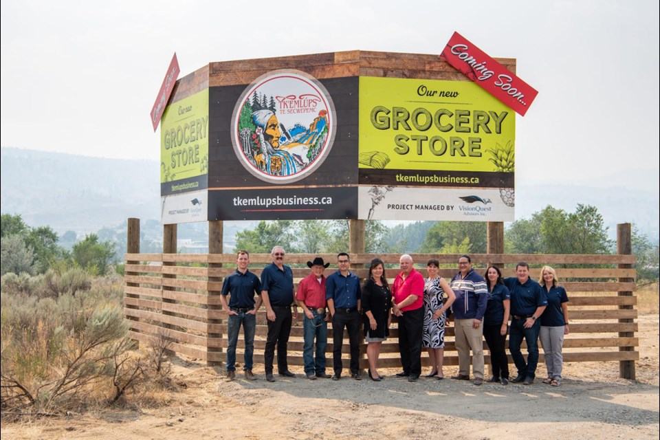 Tk'emlúps Chief Rosanne Casimir and band staff in front of the sign at Highway 5 and Shuswap Road heralding the arrival in 2023 of the Tk'emlúps Grocery Store. The store will have a major supplier, but as an independent business, there will be opportunities to incorporate local producers and traditional Secwépemc foods that may not otherwise be possible through a lease agreement with a franchise.