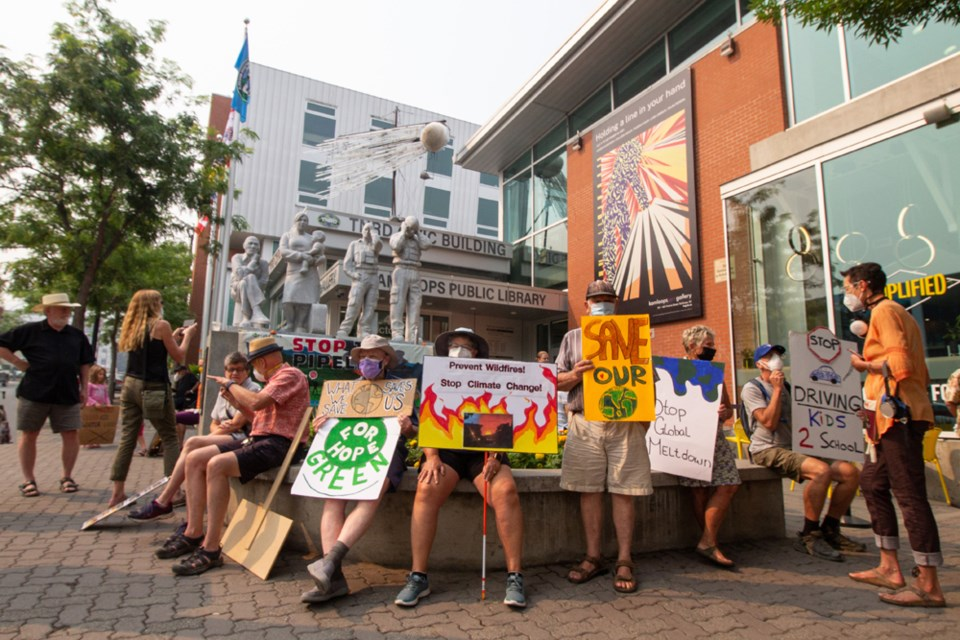 """Participants in the July 29 climate action rally came with signs in hand, adorned with slogans like """"Prevent wildfires! Stop climate change!"""" and """"The oceans are rising, and so are we."""""""