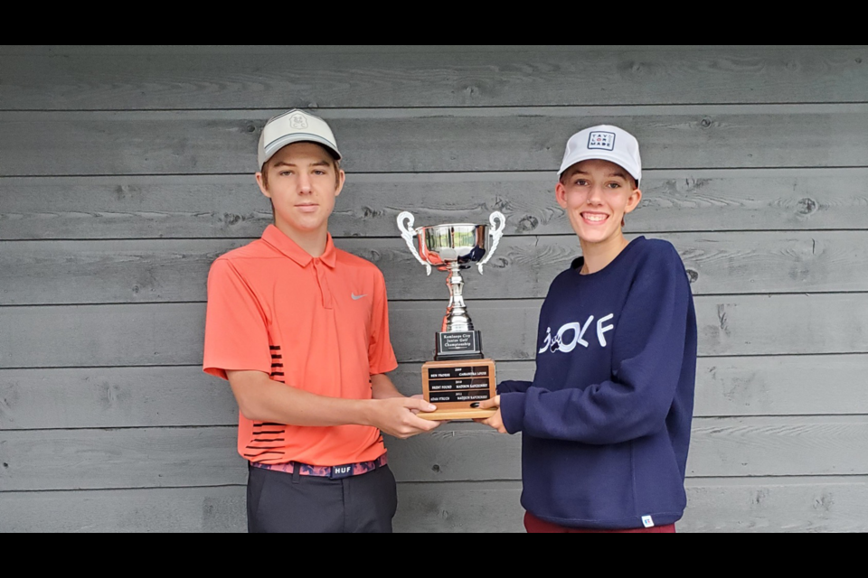 Carter Jones (left) of Rivershore Golf Links and Maddox Holliday of Okanagan Golf Club won the boys' and girls' titles, respectively, on Monday at Rivershore. Holliday shot 81 to claim the overall victory.