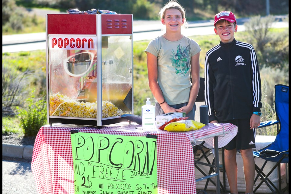 Gabrielle and Dimitri Armstrong at the popcorn stand outside their home at 2380 Qu'appelle Blvd. in Juniper Ridge.