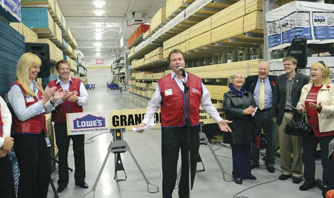 Alan Huggins, president of Lowe's Canada, addresses the crowd celebrating the opening of the first Lowe's in B.C.