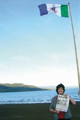 Northern adventure: Annette Martin of New Westminster took her Record along when she went to the Yukon to visit her baby granddaughter Phoenix Rose Cairns and family and friends. Here, she's at Marsh Lake, where it stays light for about 18 to 20 hours a day at this time of year.