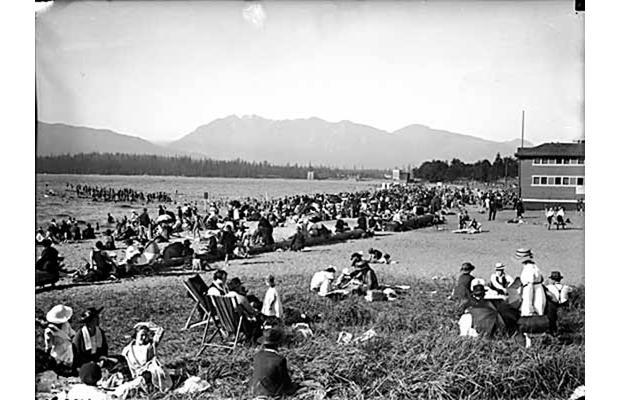 Kitsilano Beach then: Sunbathers enjoy a warm day at Kitsilano Beach in 1921.