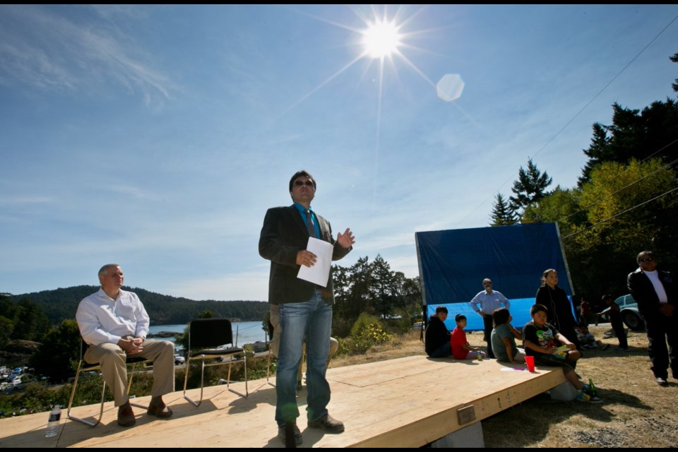 Thursday: Cheanuh Chief, Russell Chipps, speaks (developer David Butterfield on left) at a Spirit Bay announcement.