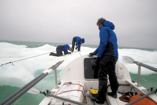 Crew members on the Arctic Joule struggle to anchor the rowboat to the ice. Scan this photo with the Layar app to see more photos and video from the expedition.