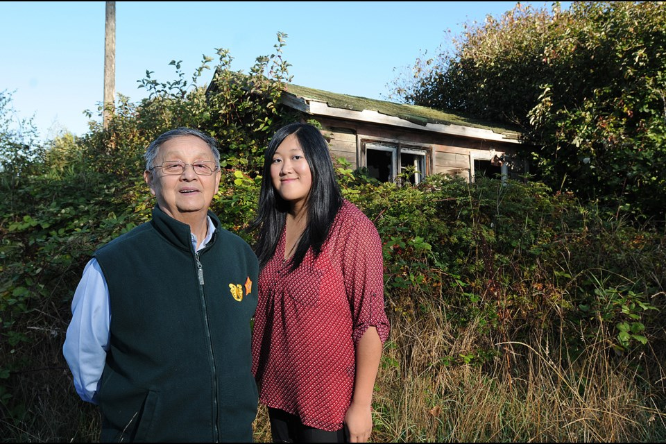 Larry Grant and Sarah Ling in front of one of the last three farmhouses left on Musqueam land. Photo: Dan Toulgoet