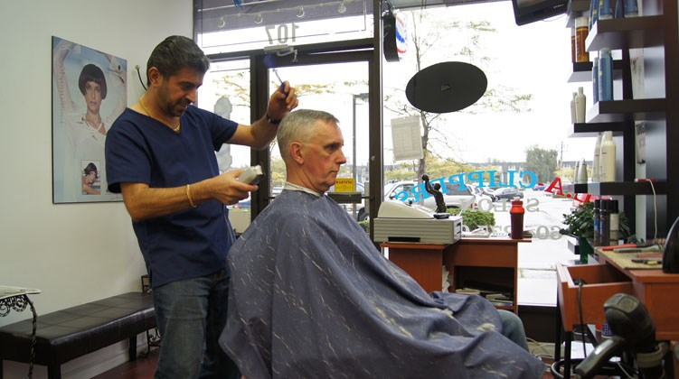 Graeme Wood/Special to the News Leo Silvo cleans up long-time regular customer Steve Plummer who comes from Steveston to Silvo's LA Clippers at Richlea Centre.