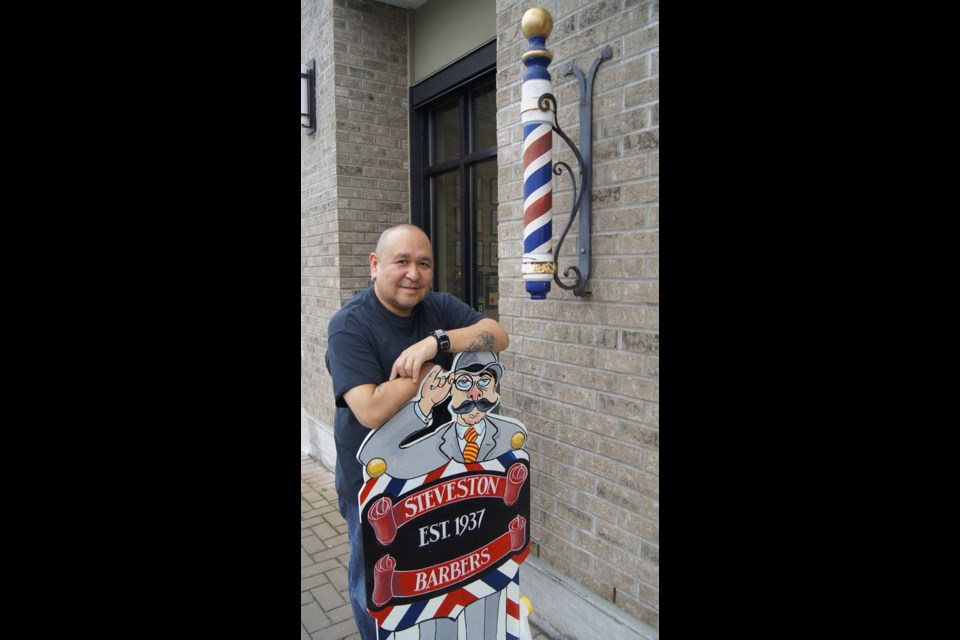 Graeme Wood/Special to the News Ray Tsuji has cut hair at Steveston Barbers for eight years and is a long-time Stevestonite.